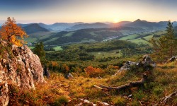 Autumn mountain panorama landcape with forest at sunset