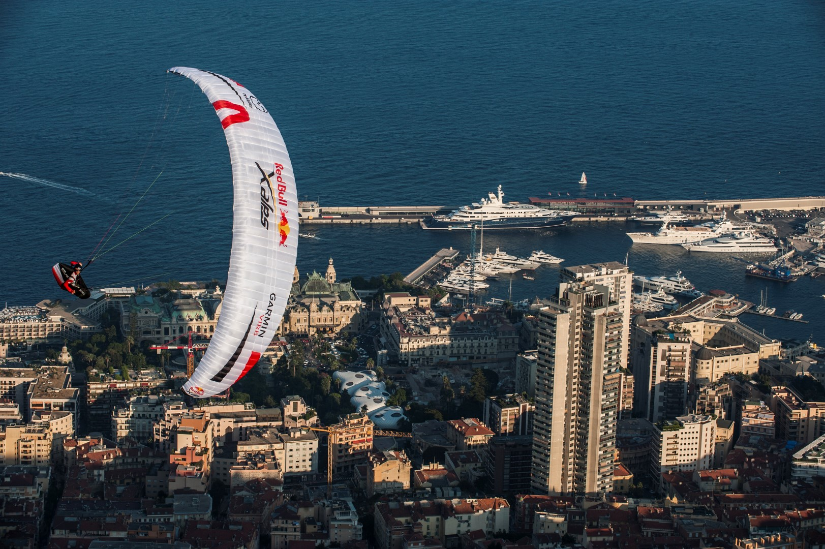 Competitors fly at the Red Bull X-Alps at Monaco, France on July 16th 2015