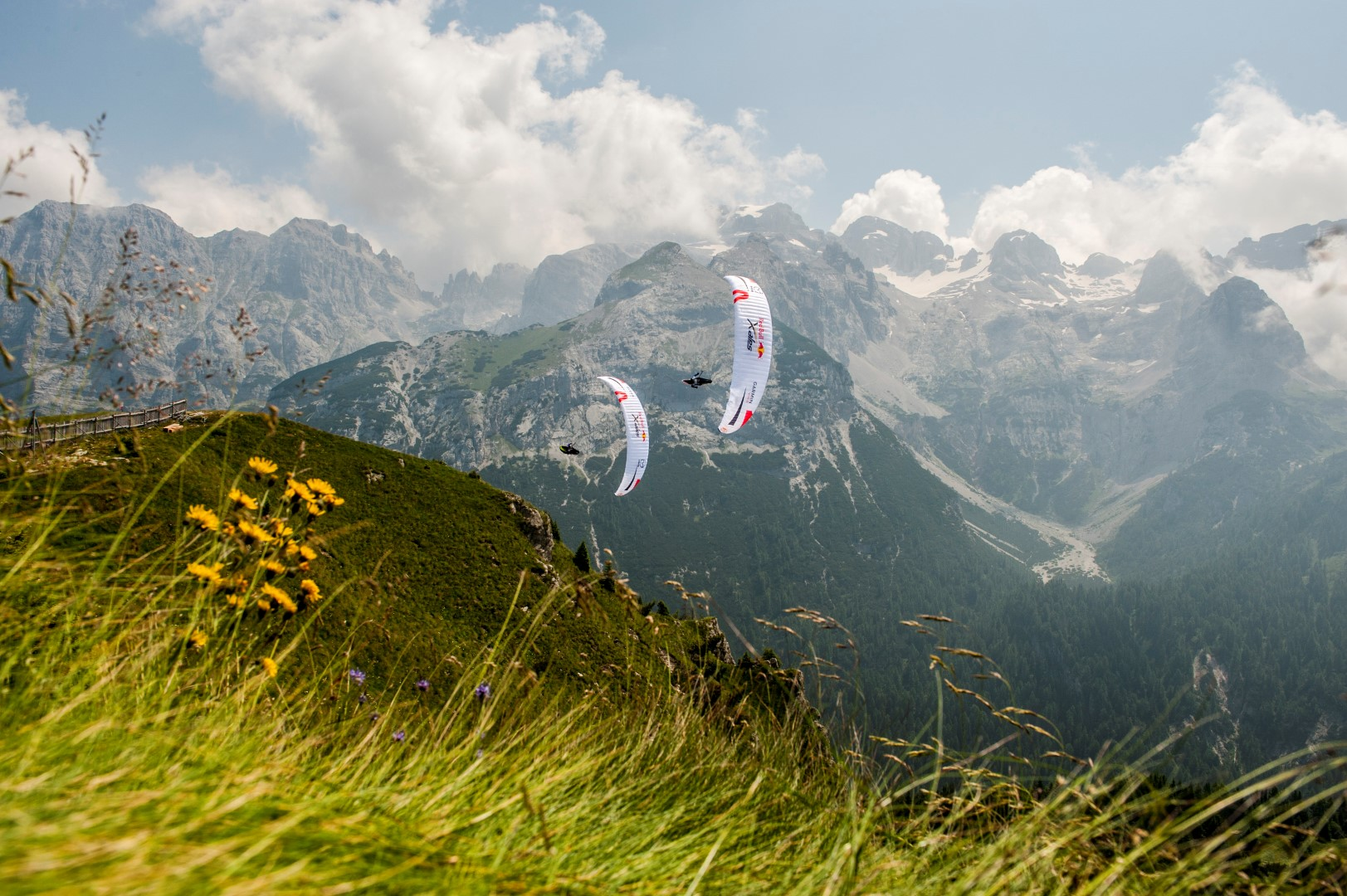 Participants perform during the Red Bull X-Alps at Brenta, Italy on July 7th 2015