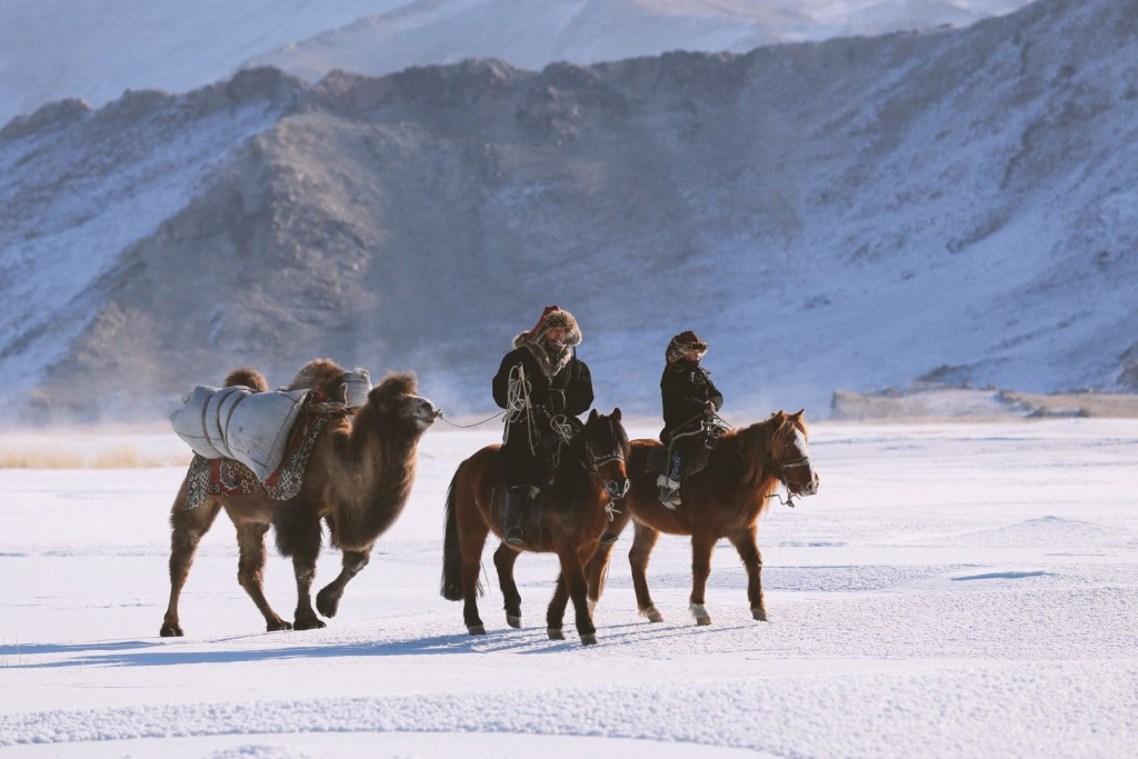 Auez (L) and his son Janibek, starting the winter migration in the Mongolia's Altai Mountains_BOY_NOMAD_Niobe_Thompson